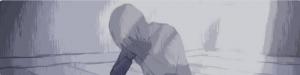 un ragazzo con la testa tra le mani a illustrare il fenomeno hikikomori